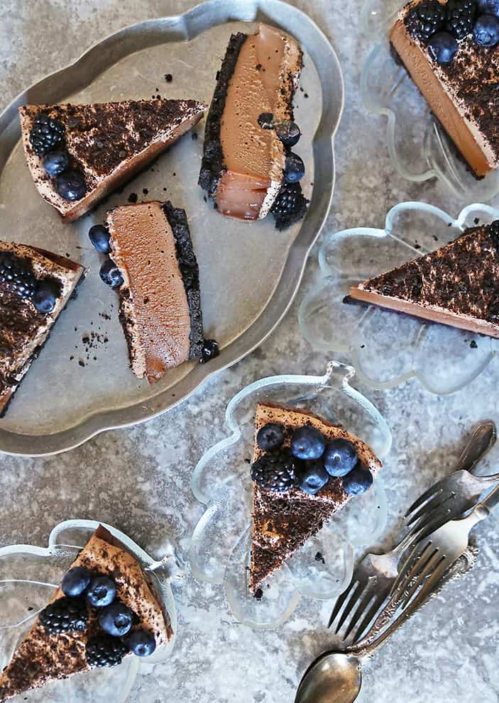 SLICES OF Tasty dairy-free no-bake chocolate dessert ON TRAY AND SERVING PLATTERS