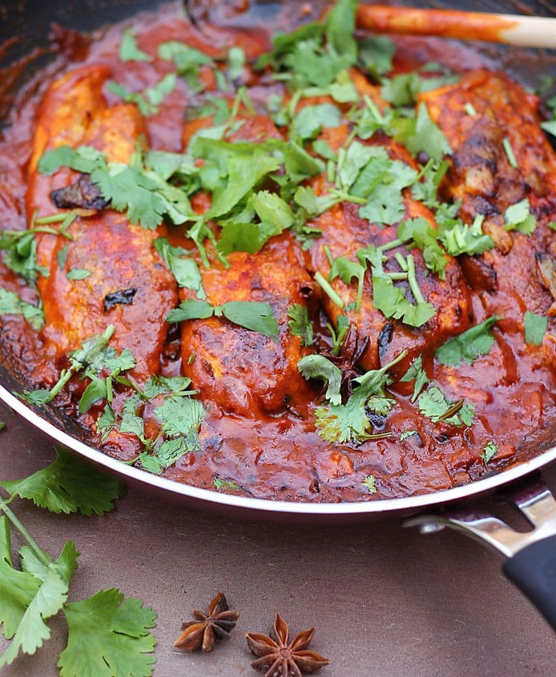 The rich color of this curry is from the paprika, cumin, coriander, cayenne and turmeric I dredged the fish with before  cooking them in a tomato, ginger, garlic, onion and coconut milk sauce. @RunninSrilankan