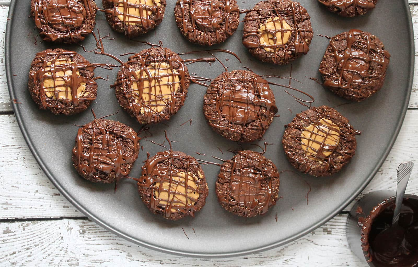 Chocolate-Drizzled-Chocolate-Peanut-Butter-Thumbprint-Cookies-@RunninSrilankan