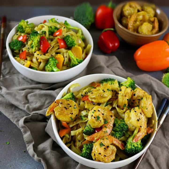 Rice Noodle, Shrimp & Veggie Coconut Curry Stir Fry - half curry, half stir fry, this recipe is sure to delight your tastebuds and it is a cinch to pull together! See the recipe at http://RunninSrilankan.com