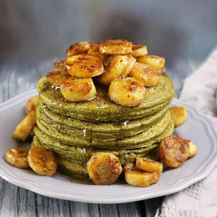 Banana Matcha Oatmeal Pancakes with Cinnamon Cream Bananas