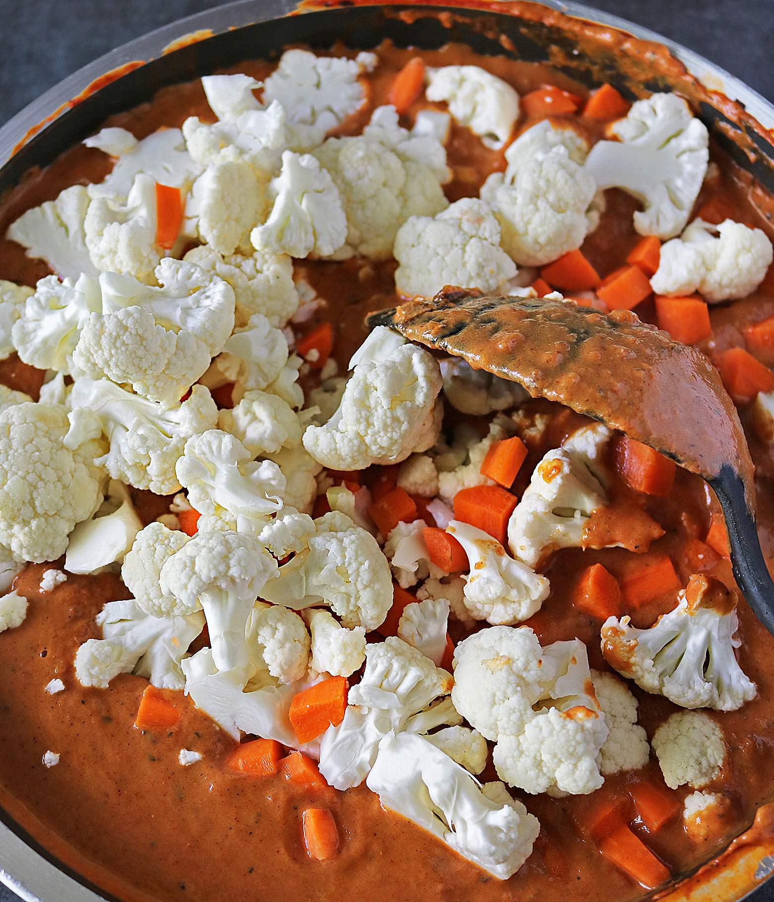 Adding Cauliflower Carrots In Tikka Sauce