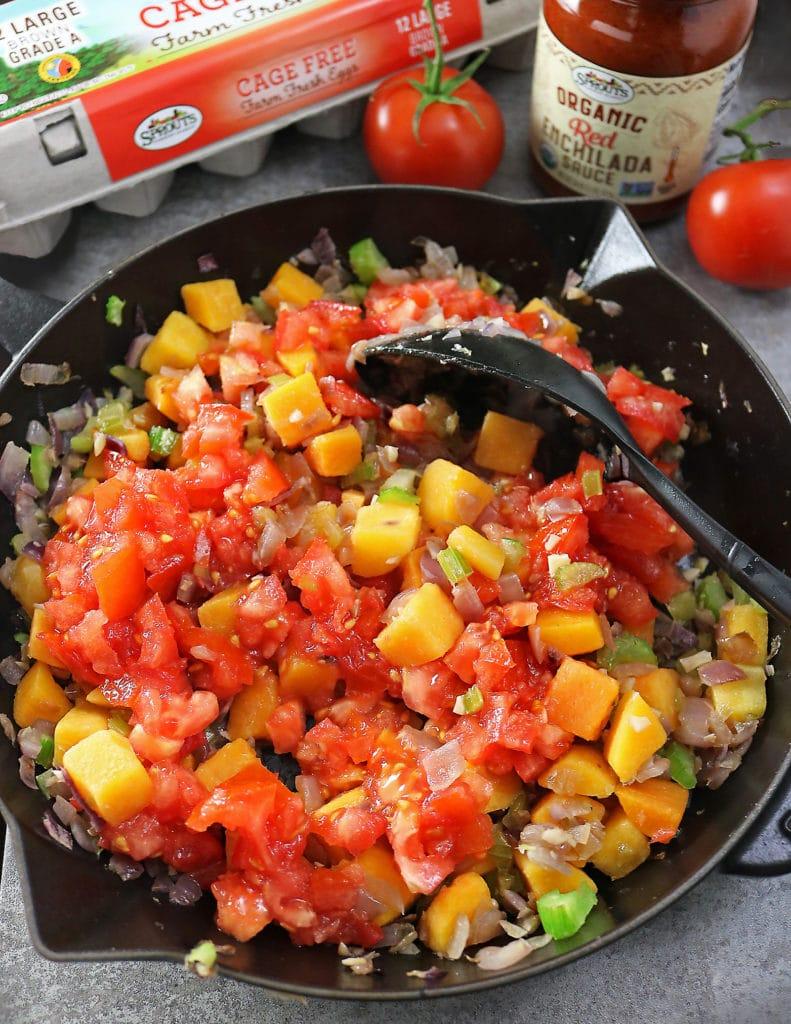 Sauteing Butternut Squash, Tomatoes, Celery, Garlic, Onions and Ginger to make Butternut Squash Enchilada Shakshuka