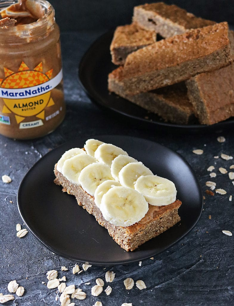 Gluten Free Almond Date Bars slathered with MaraNatha Almond Butter and topped with sliced banana