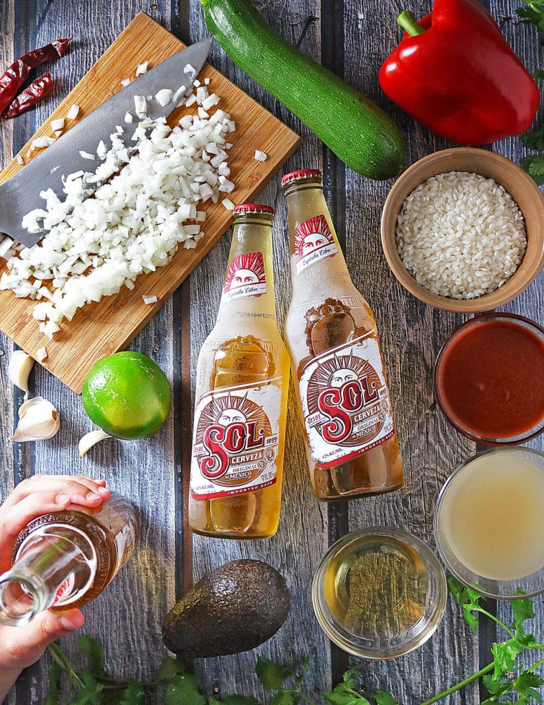 Sol Beer And Other Ingredients For Enchilada Risotto