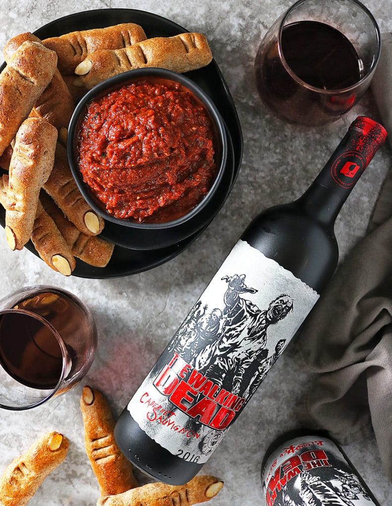 Overhead Dead Finger Breadsticks and Red Pepper Red Wine Dip and a bottle of Living Wine Labels Red Blend
