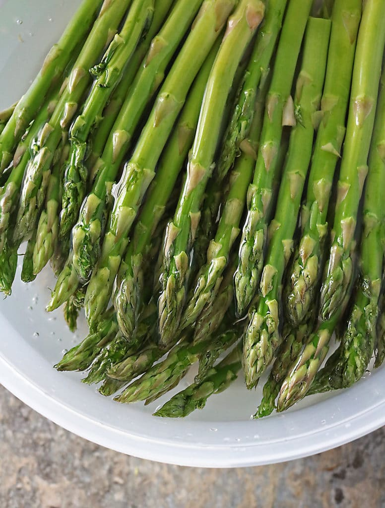 Asparagus submerged in cold water to remove grit
