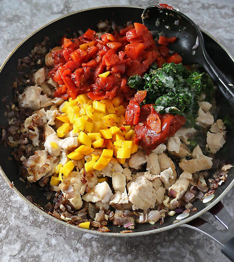 Pan with ingredients for making mango chicken