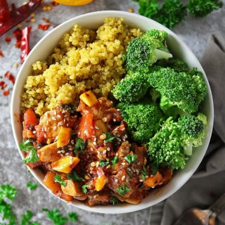 Overhead photo of bowl of Quick and Easy Mango Chicken, turmeric quinoa and broccoli