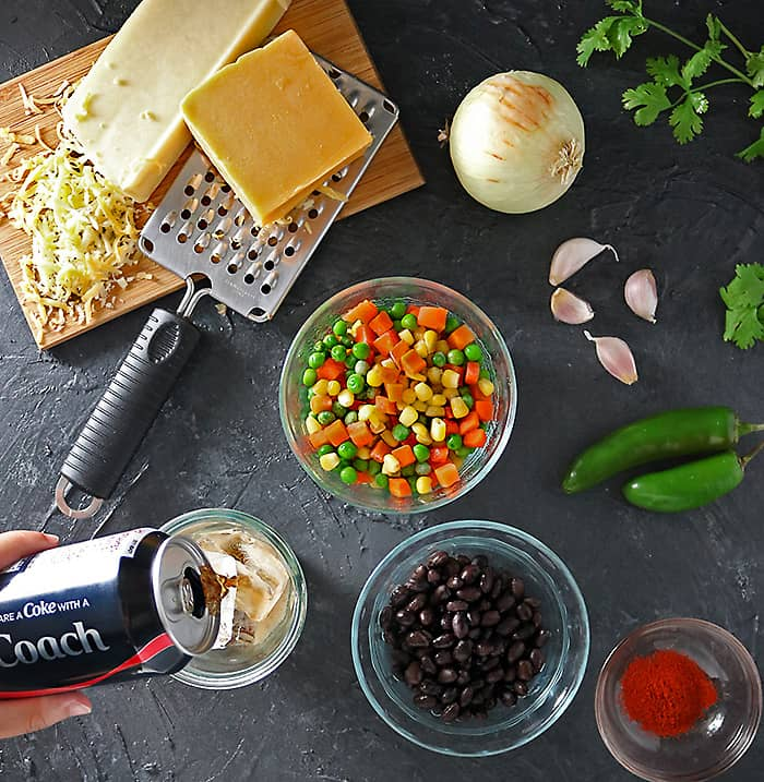Photo of Coca-Cola And-Ingredients For Spicy Veggie Quesadilla
