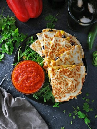 Overhead photo of Delicious Spicy Veggie Quesadillas And Coca-Cola for FIFA Viewing Party