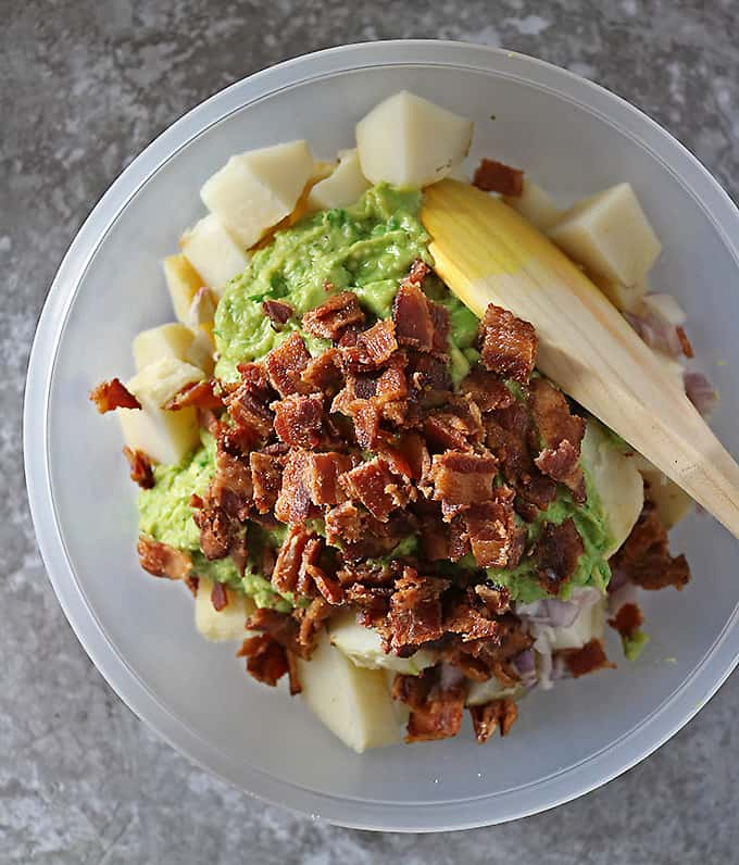 Photo of mixing together potatoes, bacon, and avocado dressing
