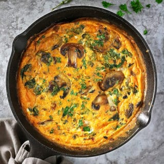 Overhead view of skillet with mushroom spinach bake