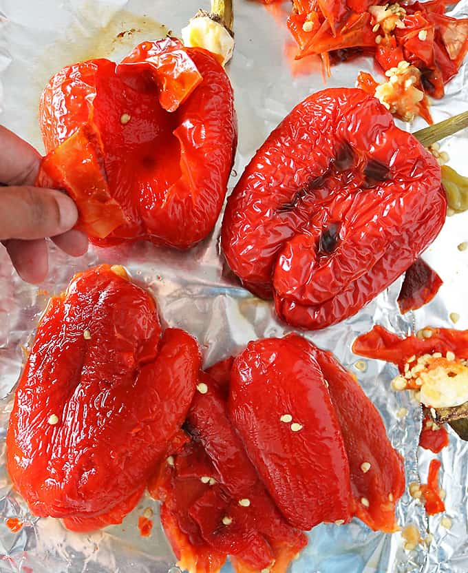 Photo of peeling the skin off of oven roasted red peppers