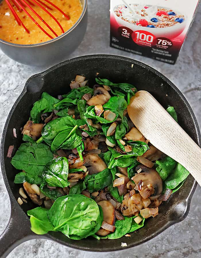 Sauteing mushrooms, spinach, onions and garlic