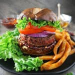 Photo of mile high plant based Beyond Burgers with Sweet Chili Sauce
