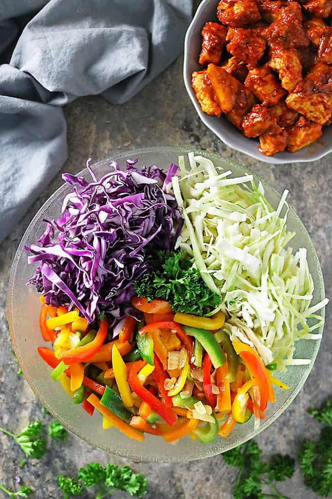 Making Cabbage Pepper Salad And Pineapple Pork in a bowl