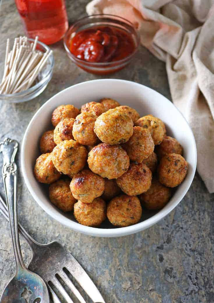 These Gluten-free, Baked, Spicy Chicken Meatballs are so easy to make and are delicious dipped in your favorite sauce or dropped into a curry.