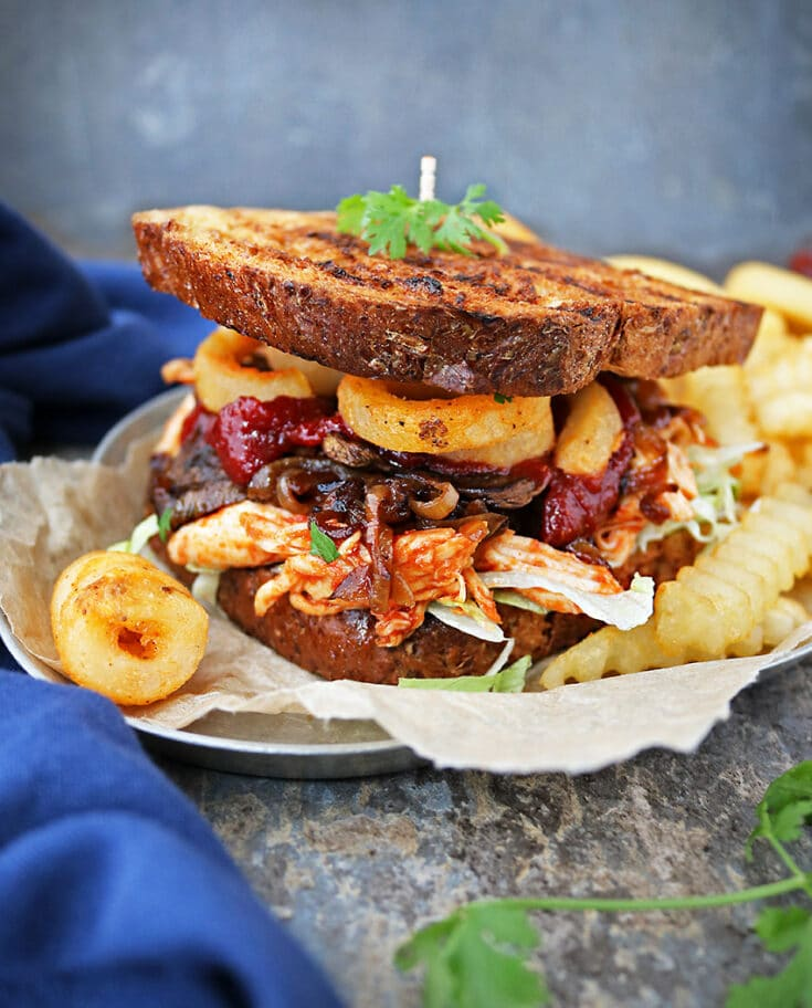 This piled-high, layered, Sweet Spicy Chicken Fries Sandwich is a messy sandwich – one you will need a plate for! But, it sure is blissful taking a big bite of all the mingling textures and flavors of those different layers !