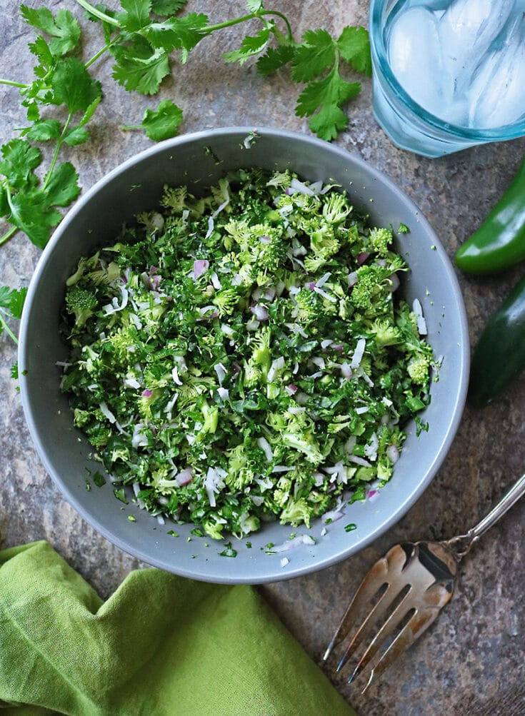 Cilantro, broccoli and kale are the stars of this delicious Broccoli Kale Cilantro Sambol (Salad). It pairs well curries and rice just as well as it would pair with burgers and fries.