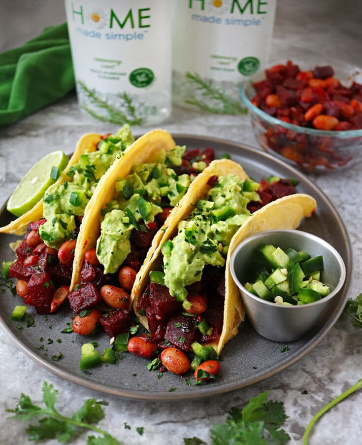 Gorgeous beetroot and filling Pinto Beans are sautéed in onions, ginger, garlic and a tasty blend of spices, piled onto tacos and topped off with creamy guacamole in these tasty (yet messy), vegetarian HeartBeet Bean Tacos!