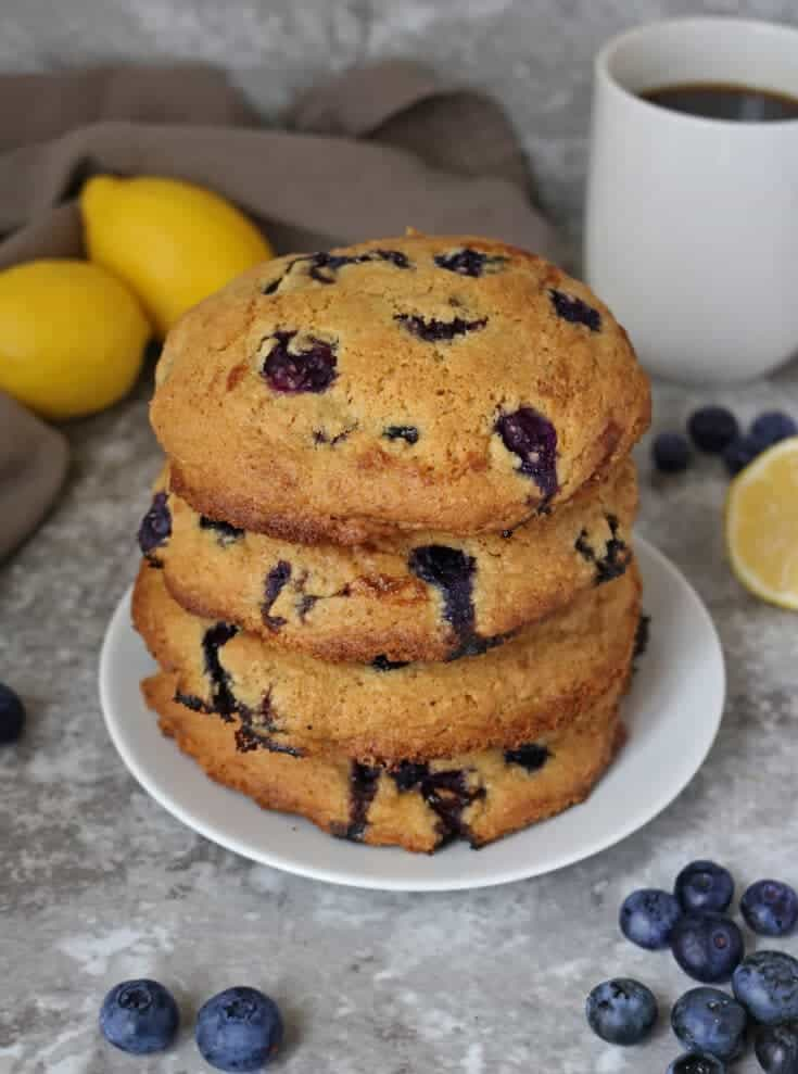 With a slightly crisp outer layer and a deliciously soft middle, these Gluten Free Lemon Blueberry Muffin Tops are packed with lemon zest, cardamom and plump blueberries. Also dairy free, these baked goods are delicious for a weekend breakfast with a cup of your favorite coffee.
