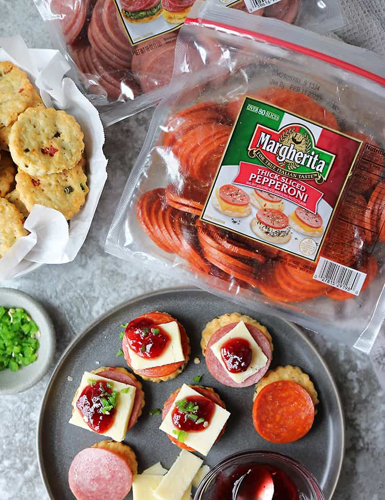 Putting together Pepperoni Cheddar Jalapeno Cracker Appetizers for holiday parties