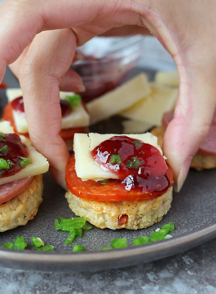 These homemade Cheddar Jalapeño Pepperoni Cracker appetizers are a favorite in our home. The unique flavor combination of these crackers with Margherita® Thick Sliced Pepperoni (or Margherita® Hard Salami), a piece of cheddar, sweet raspberry jam and crisp and fresh jalapeño, has our tastebuds singing!