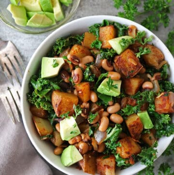 Vegan Black-Eyed Peas Recipe with Greens Hash in a bowl with a fork on the side.