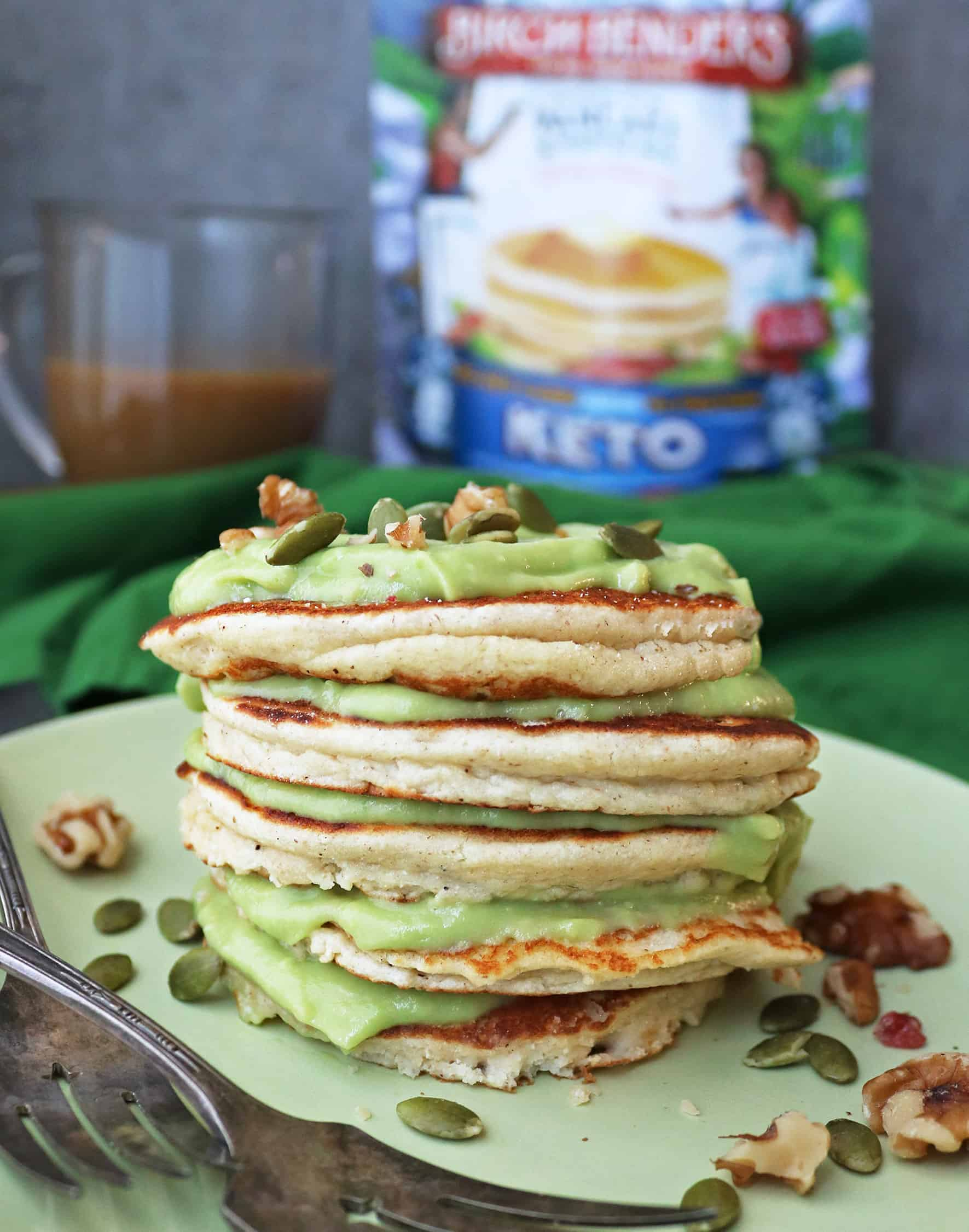 Stack of Tasty LowCarb Keto Pancakes With Sweet Keto Avocado Cream between each pancake.