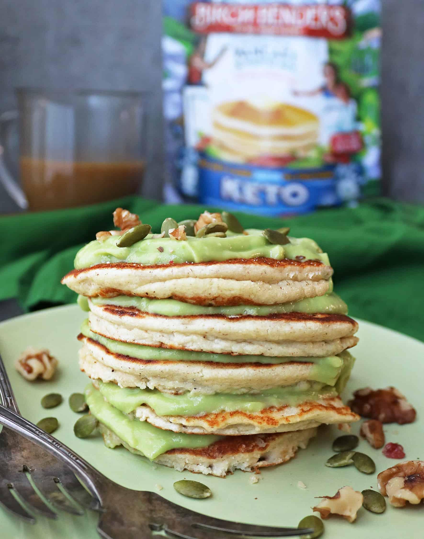 Stack of Tasty LowCarb Keto Pancakes With Sweet Keto Avocado Cream between each pancake.