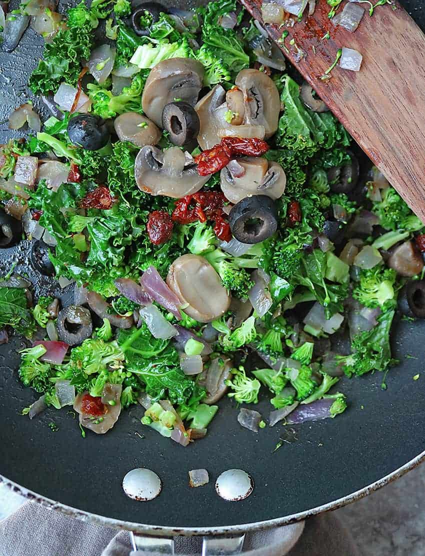 sautéed mix of kale, broccoli, onion, sundried tomatoes, mushrooms and olives