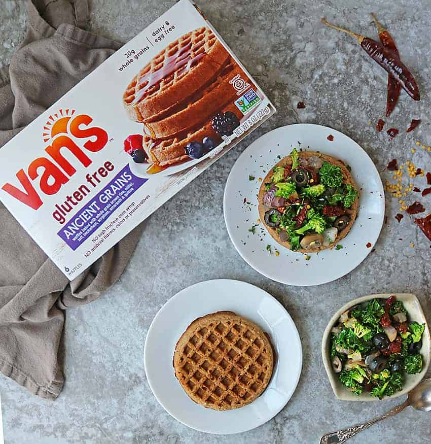 Well-toasted Van's® Gluten Free Ancient Grains Waffles topped with a sautéed mix of kale, broccoli, onion, sundried tomatoes, mushrooms and olives.
