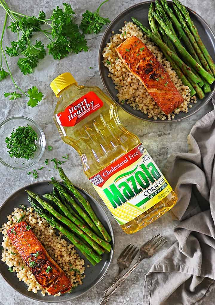 Tasty Easy Harissa Salmon with Asparagus and Israeli Couscous with Mazola Corn oil - flatlay.