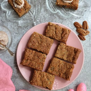 a plate of Gluten-free Dairy-free paleo carrot cake bars for Easter.