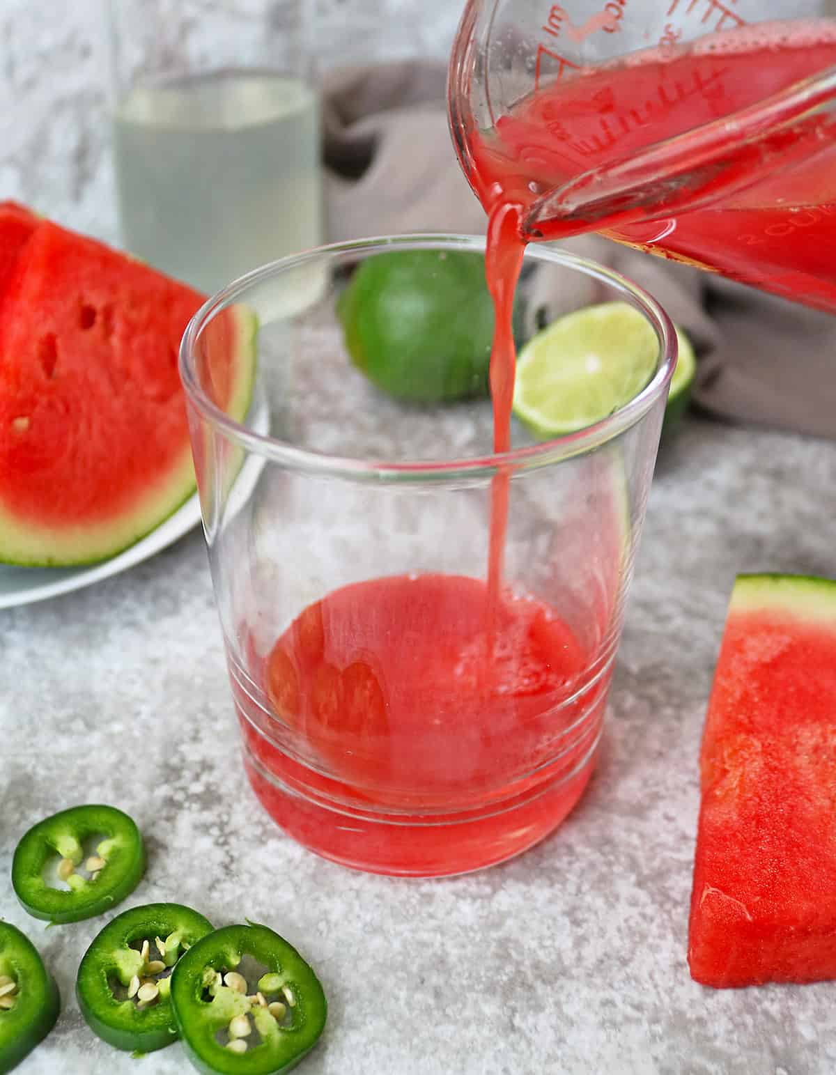 Pouring Delicious watermelon juice into a glass to make the paloma