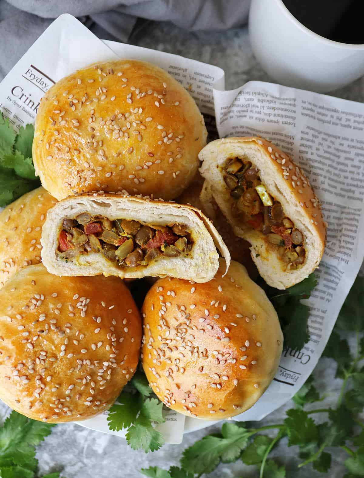 plate of stuffed buns with Ginger, garlic, onions, coriander, smoked paprika, turmeric, canned lentils, and canned tomatoes.