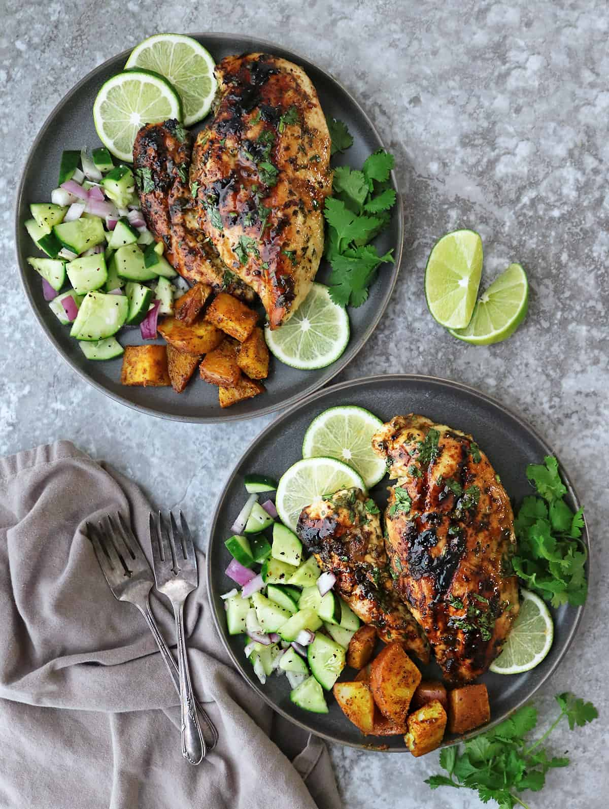 Two plates with a delicious dinner of grilled cilantro lime chicken