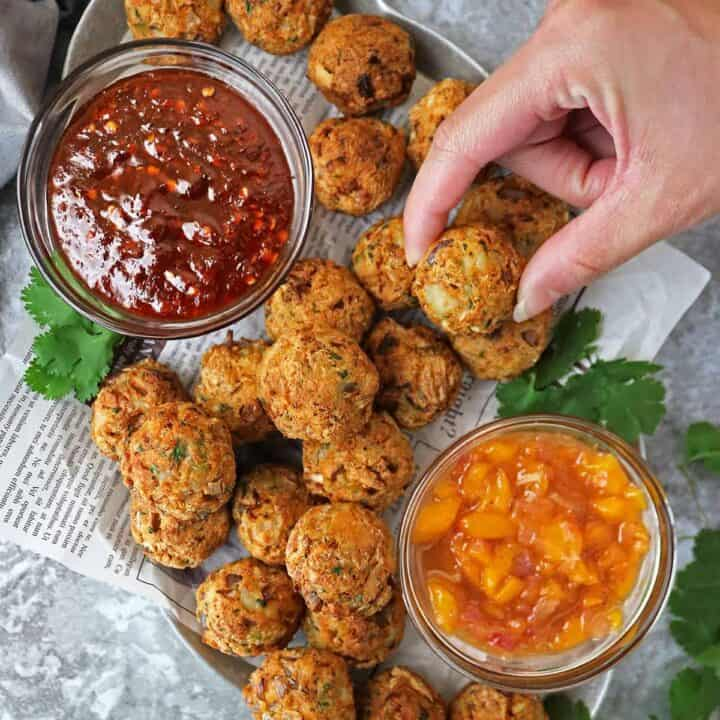 Platter of air fried salmon croquettes with mango chutney and sweet chili sauce.