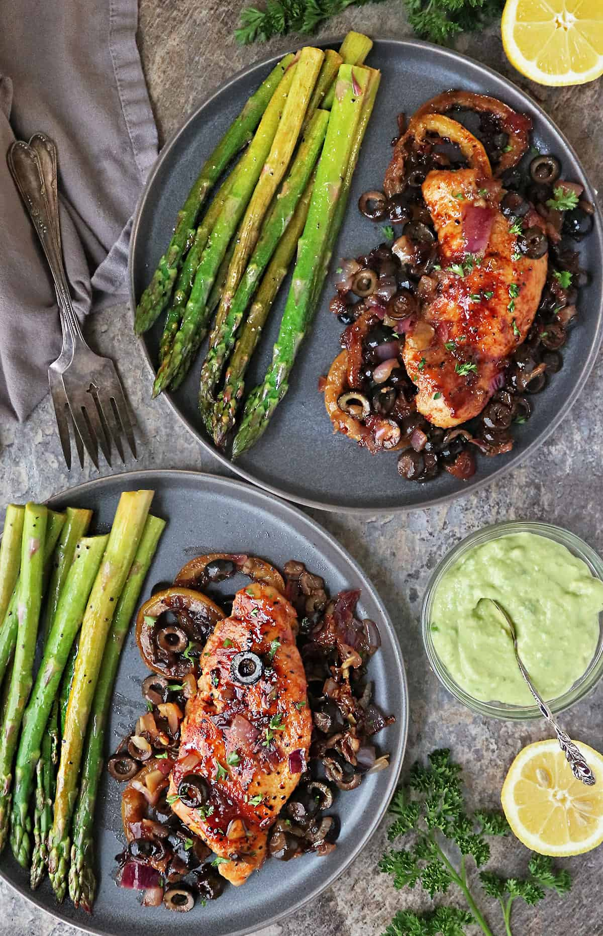 Honey lemon chicken plated with asparagus and wasabi avocado sauce