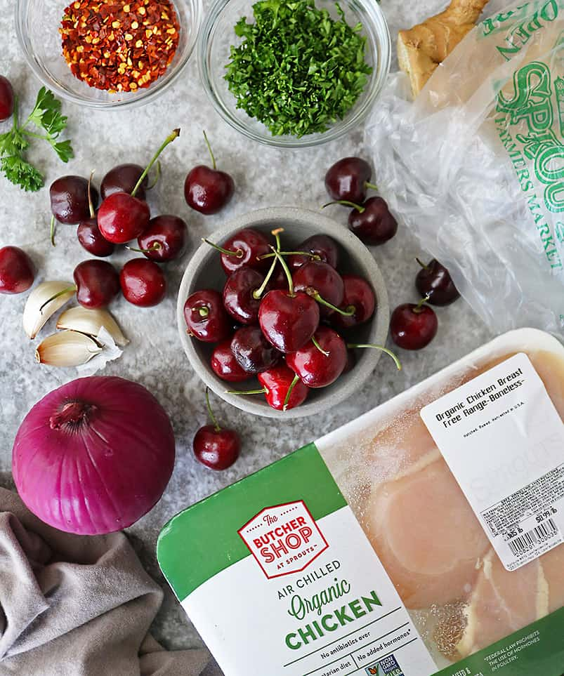 Overhead photo of Delicious Cherries from Sprouts and other ingredients to make handheld chicken cherry pies.