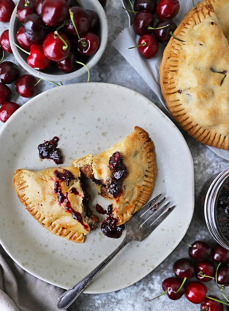 A Savory cherry chicken hand pie on a plate.