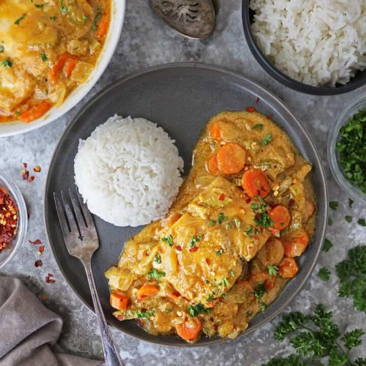 plate with Thai Thai Yellow Curry with Mahi Mahi and rice.