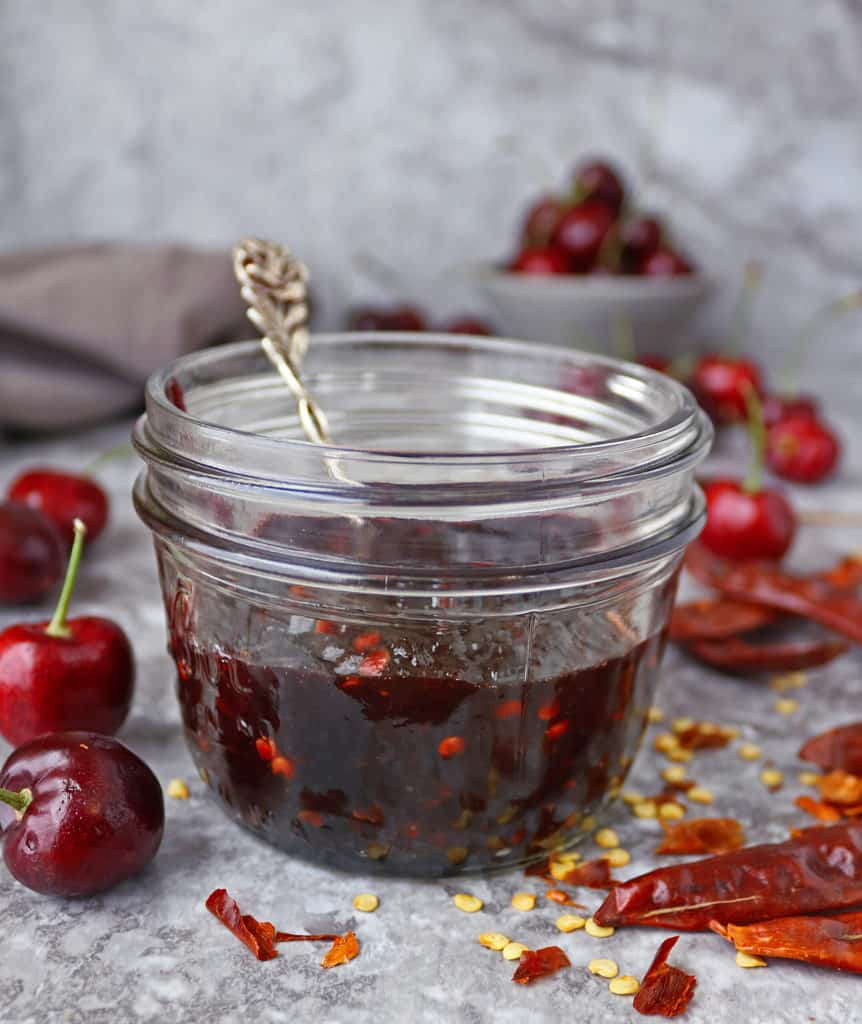 jar with delicious easy spicy cherry sauce