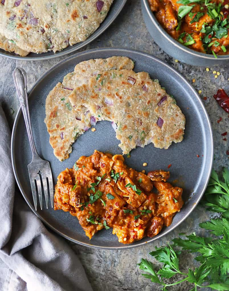 plate with easy jackfruit curry and onion coconut roti
