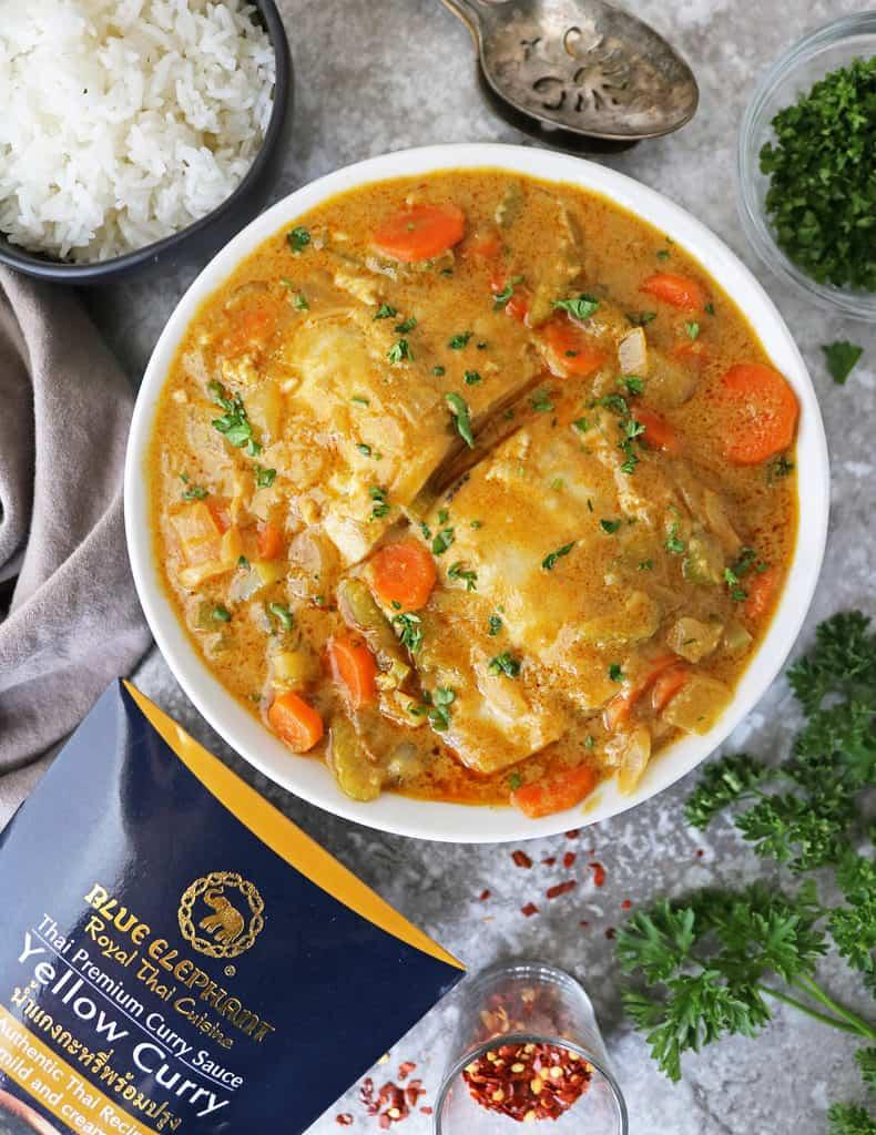 Big bowl with mahi mahi Thai yellow curry
