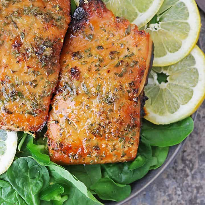 A plate with 2 fillets of honey lemon salmon - air fried to perfection.