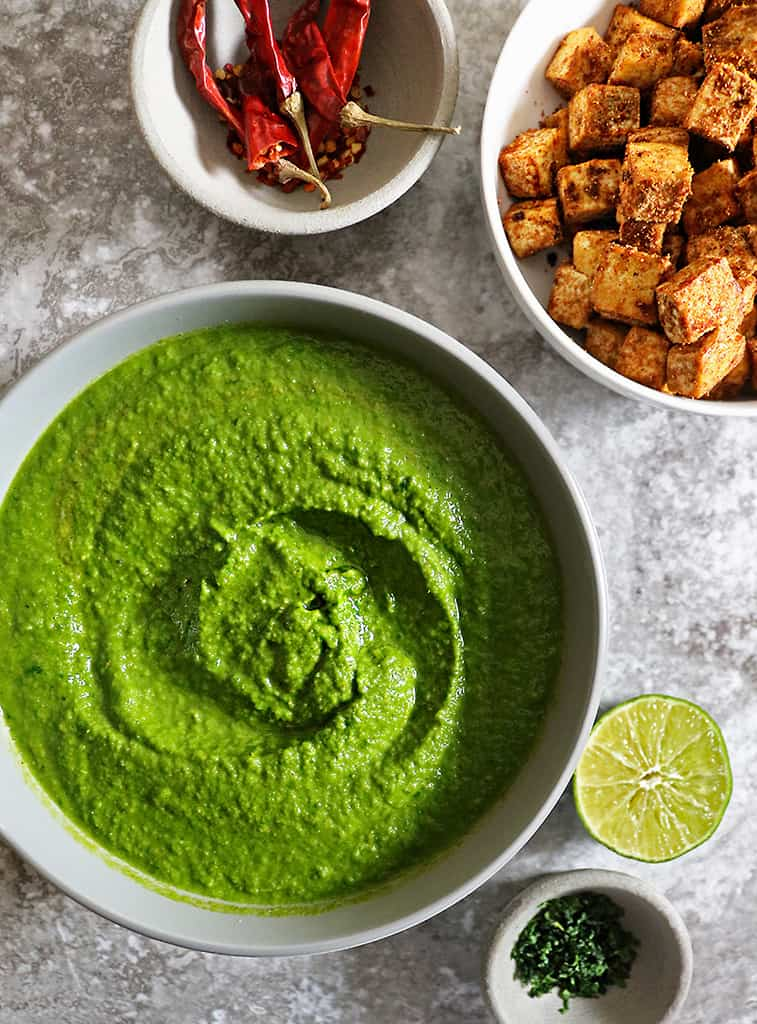 delicious spinach curry sauce and crispy tofu on side