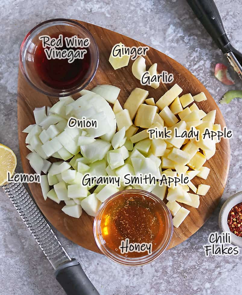 ingredients to make this apple chutney on a cutting board
