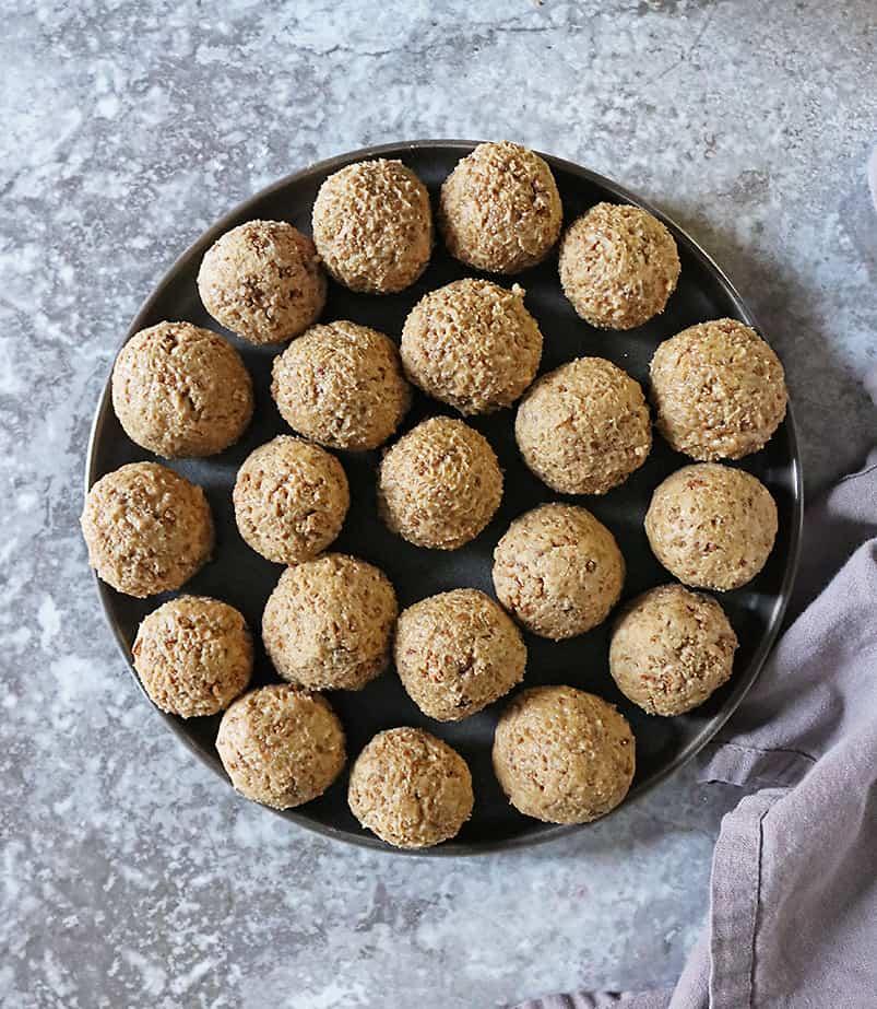 a plate of rolled crunchy peanut butter balls